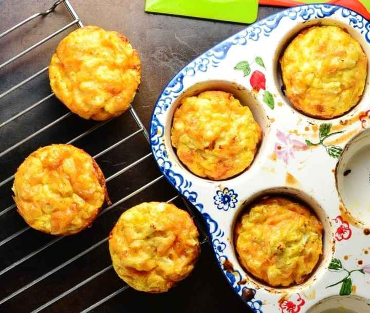 Top down view of sweet potato egg muffins in ceramic pan and on top of cooling rack.