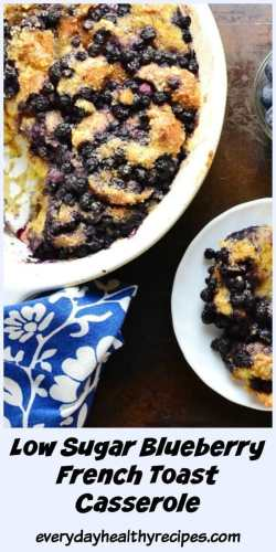 Top down view of blueberry french toast casserole in white dish and on white plate with blue-and-white cloth in bottom left corner.