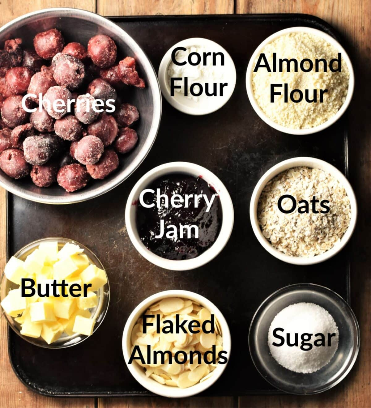 Cherry crumble ingredients in individual dishes.