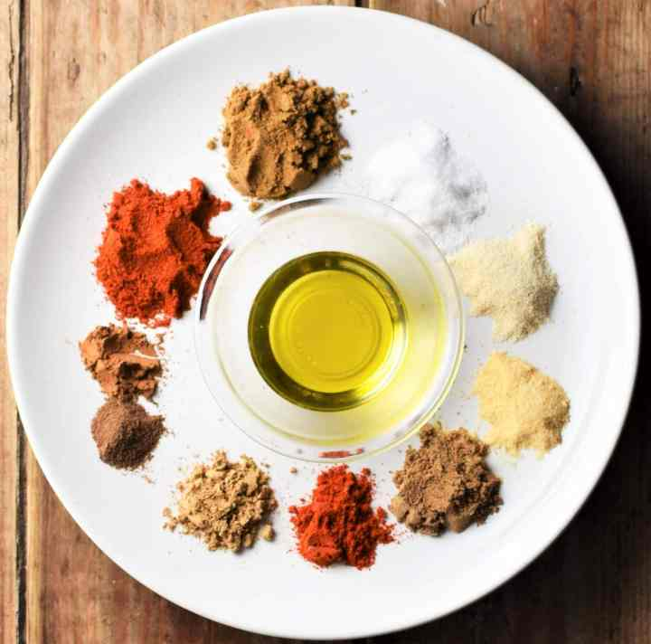 Spices and oil on top of plate.