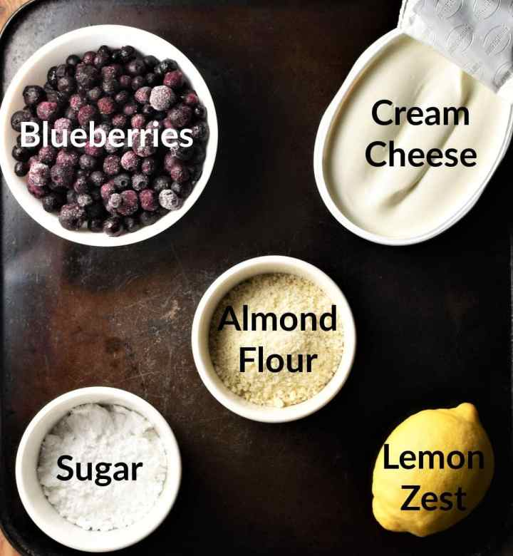 Blueberry cream cheese dessert ingredients in individual dishes.