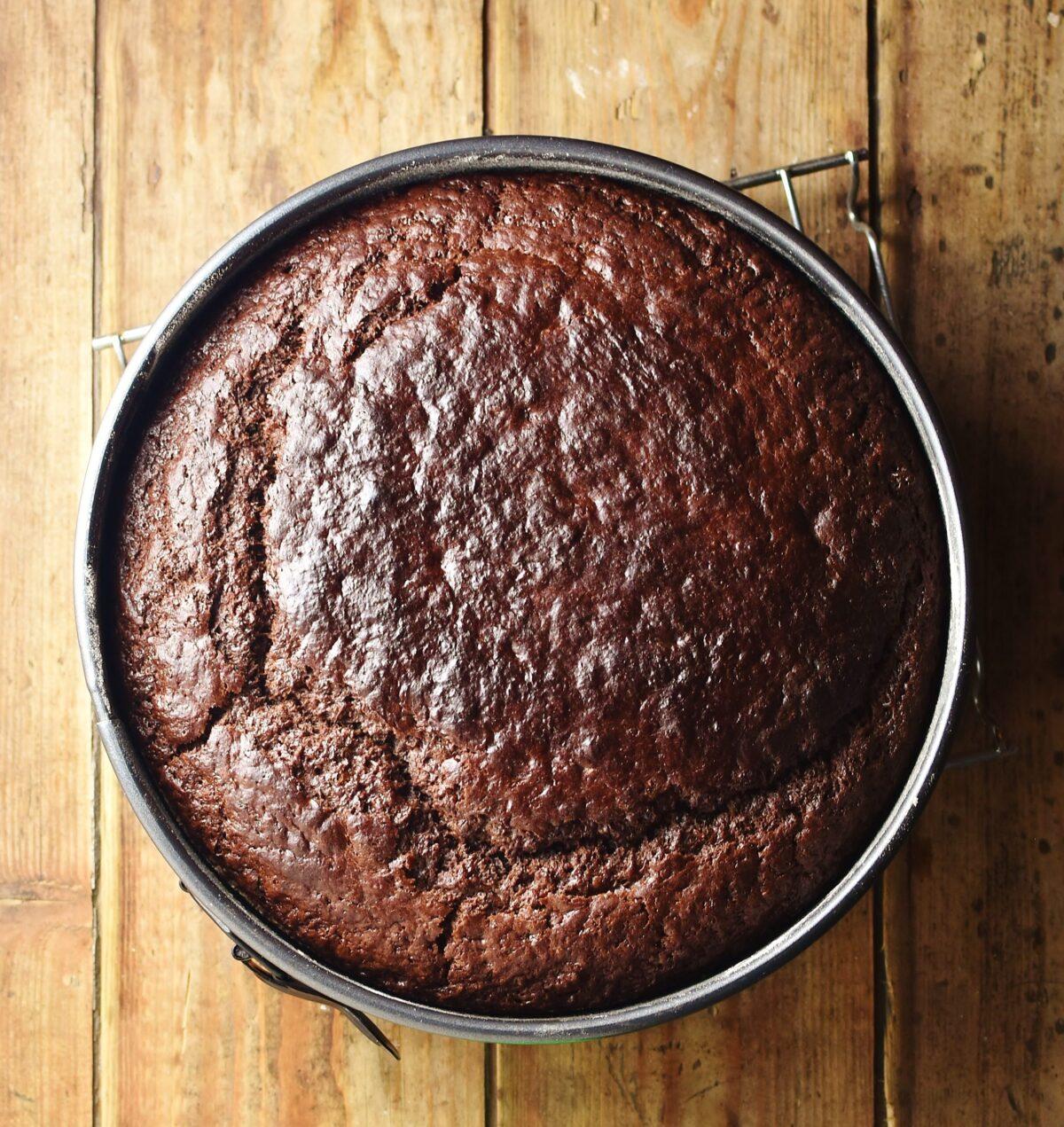 Baked banana chocolate cake in round pan.