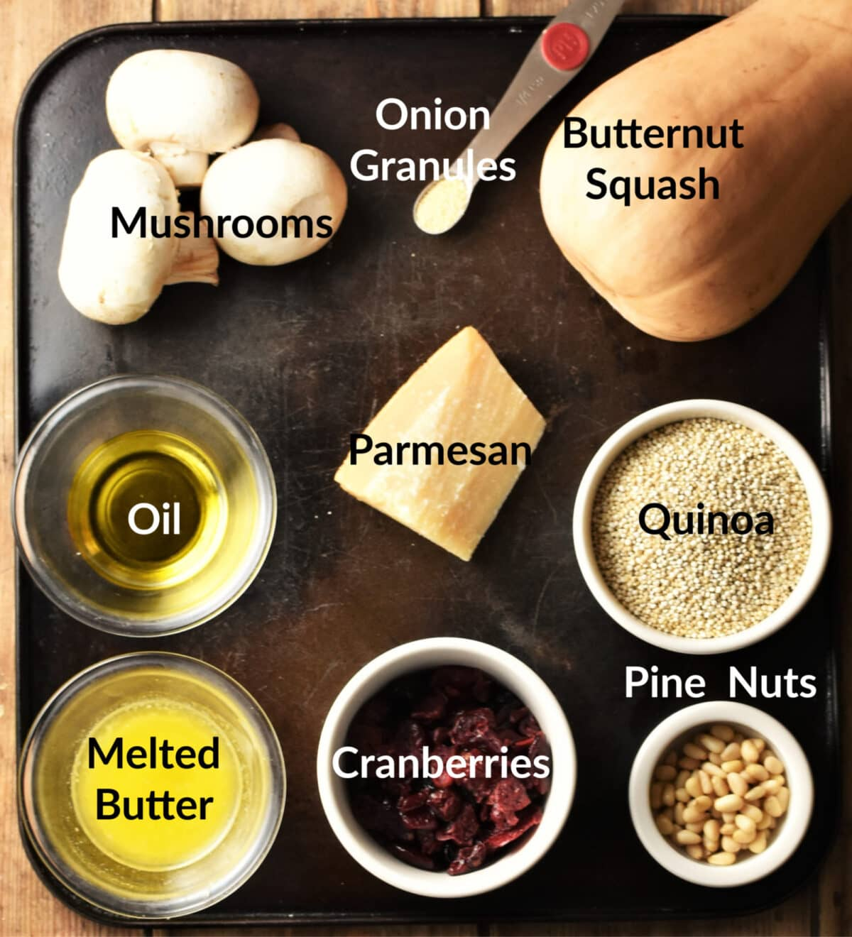 Stuffed butternut squash ingredients in separate dishes.