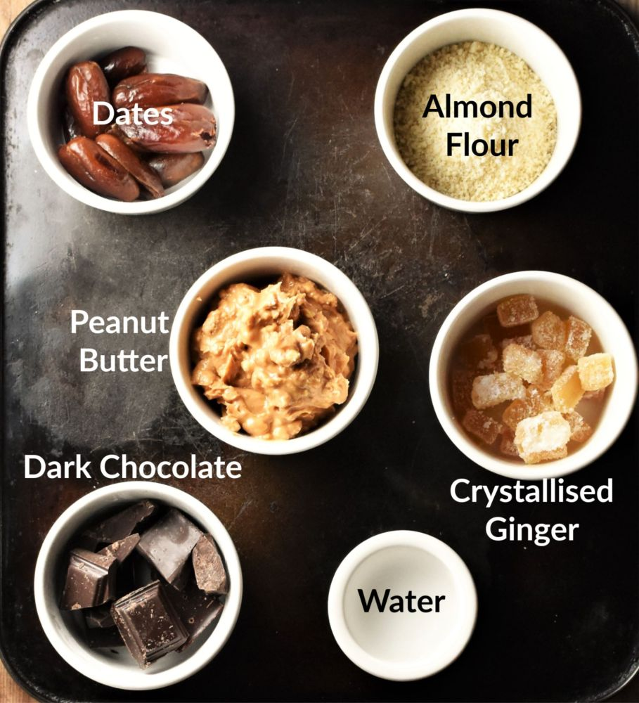 Peanut butter truffle ingredients in individual dishes.