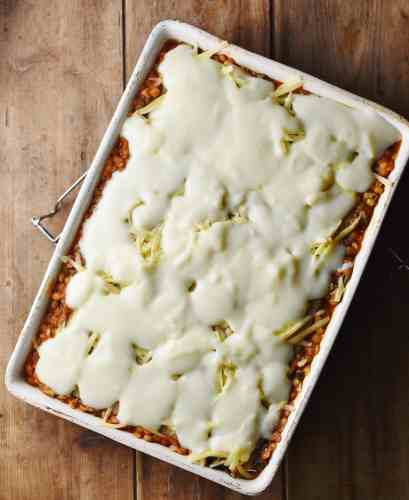 Unbaked lasagna with white sauce.