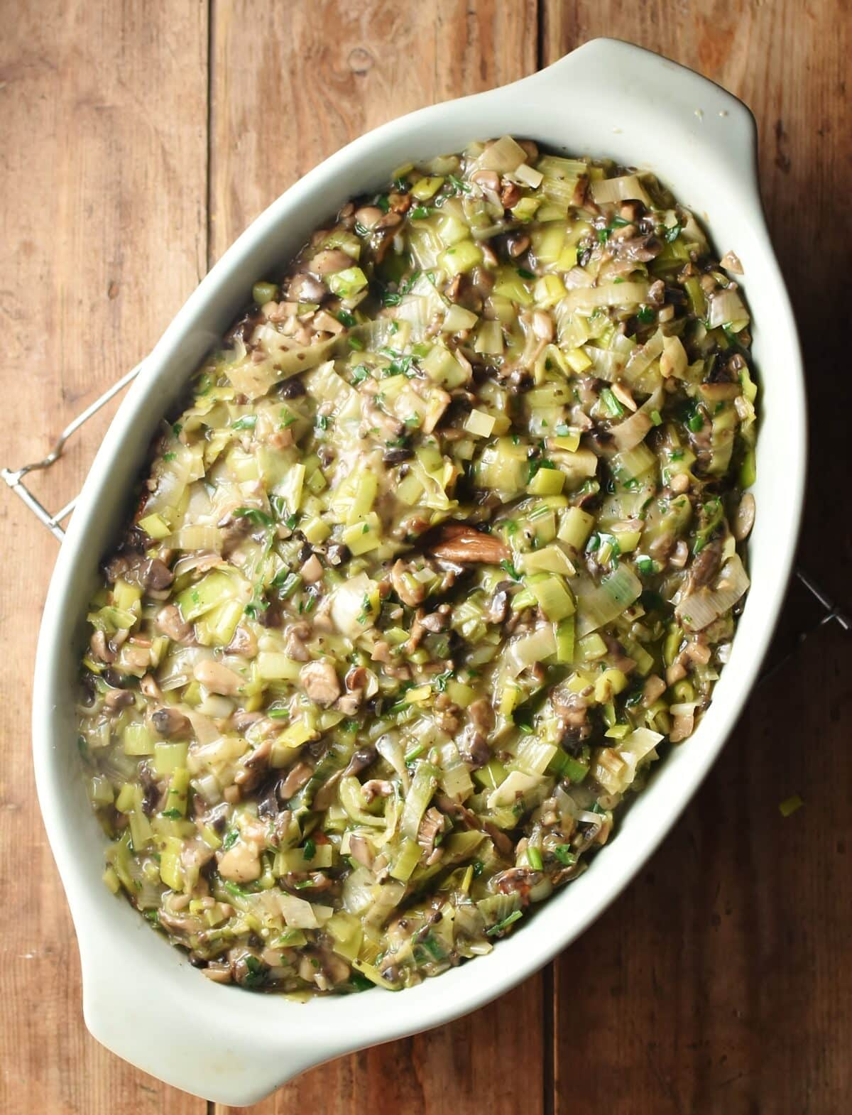 Creamy mushroom and leek mixture in oval casserole dish.