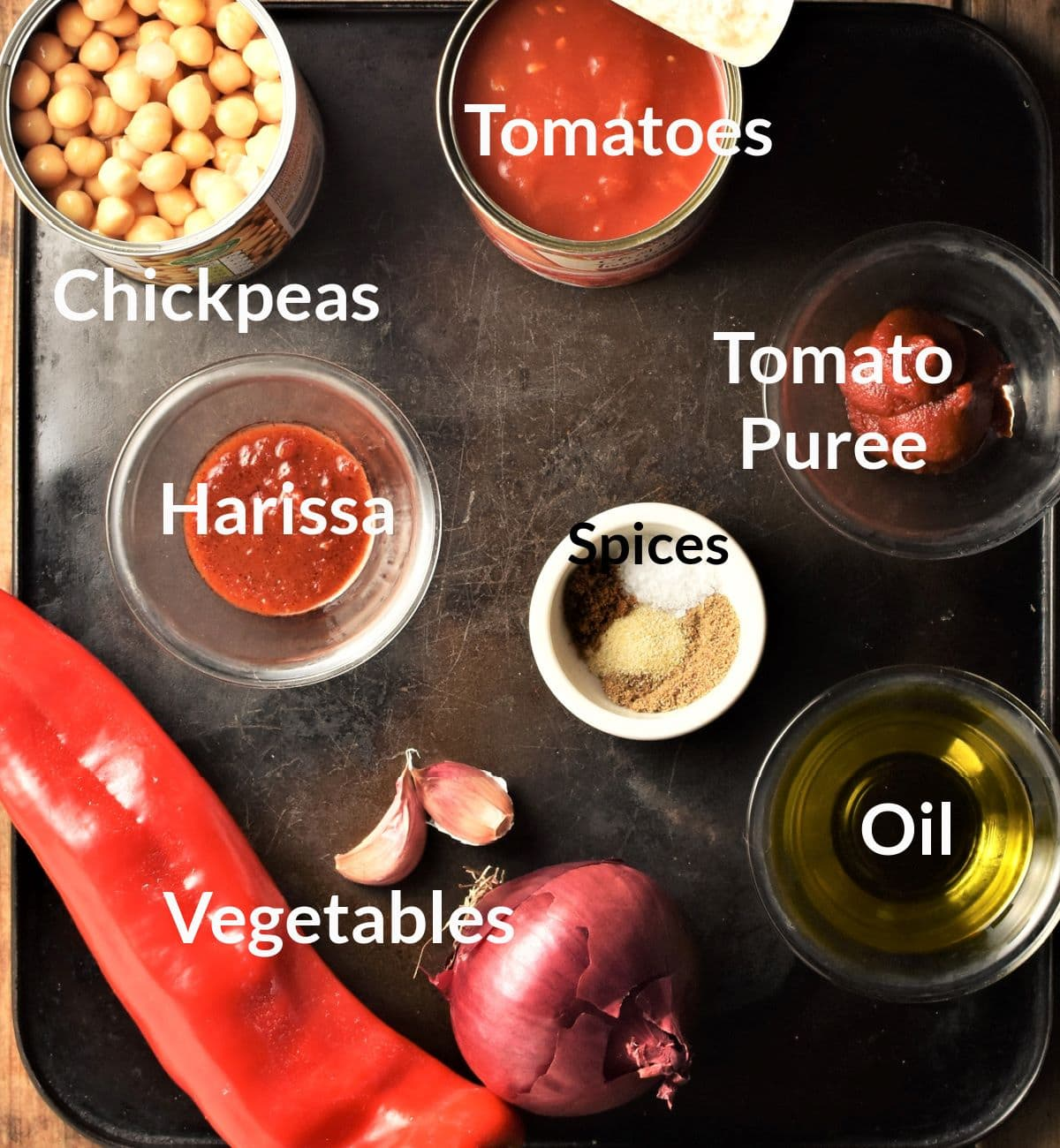 Ingredients for making vegan chickpea stew in individual dishes.