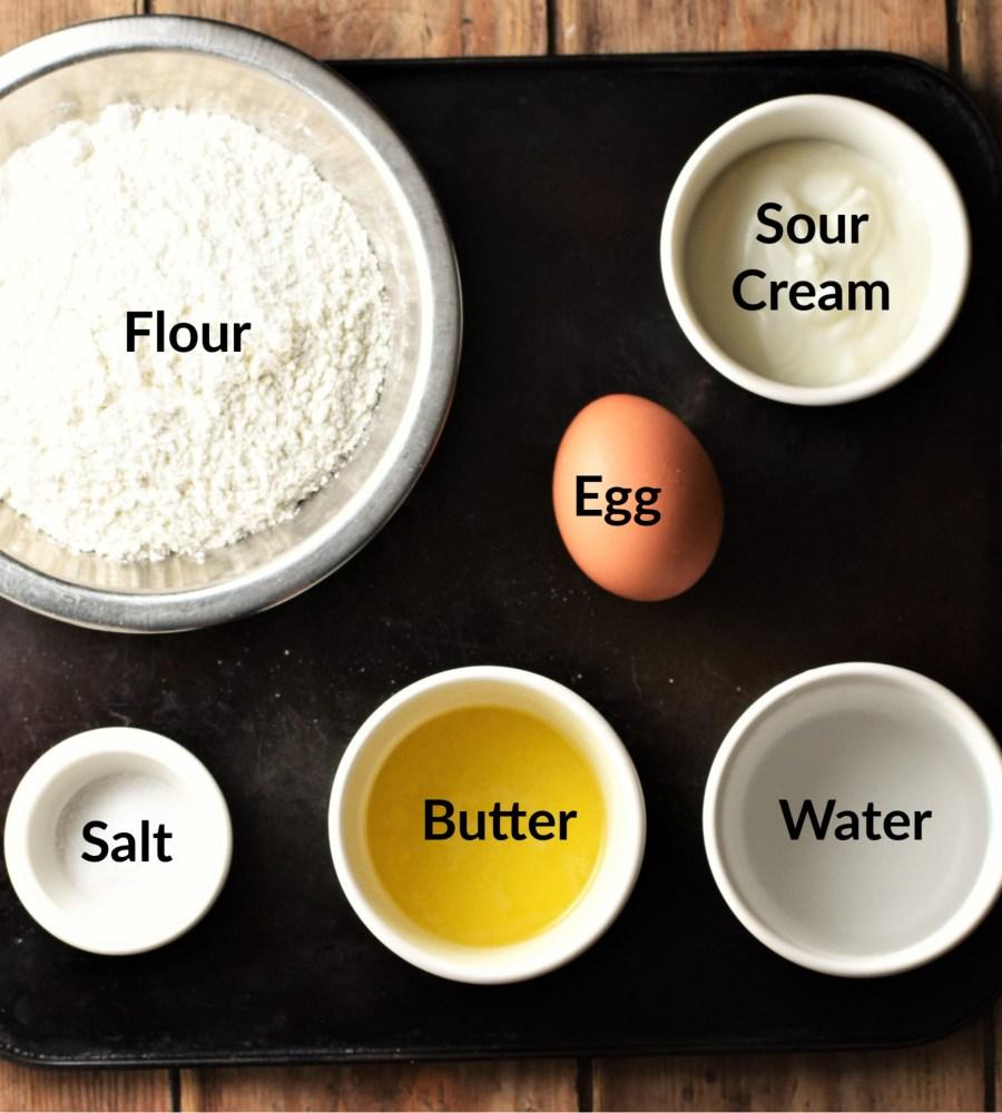 Pierogi dough ingredients in separate dishes.