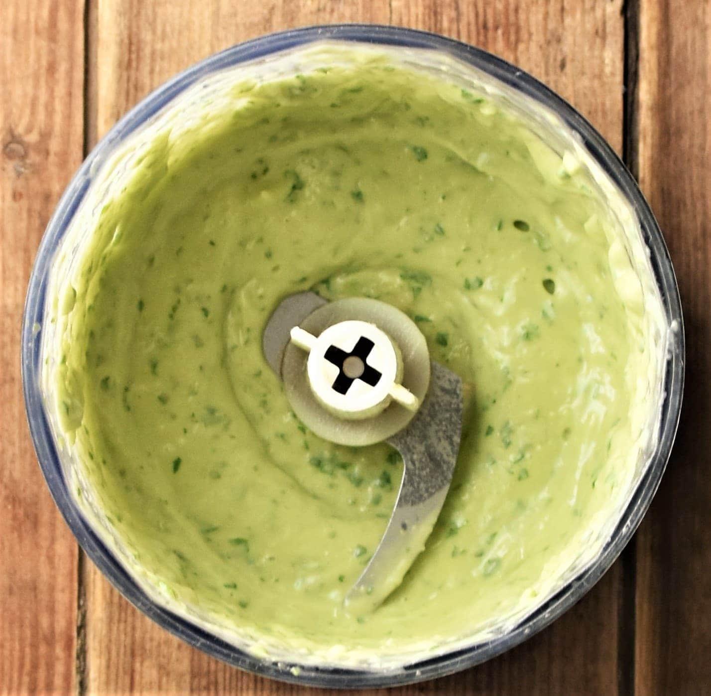 Creamy avocado sauce in blender.