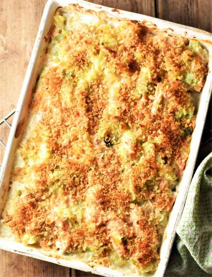 Top down view of salmon leek pasta bake with crispy topping.