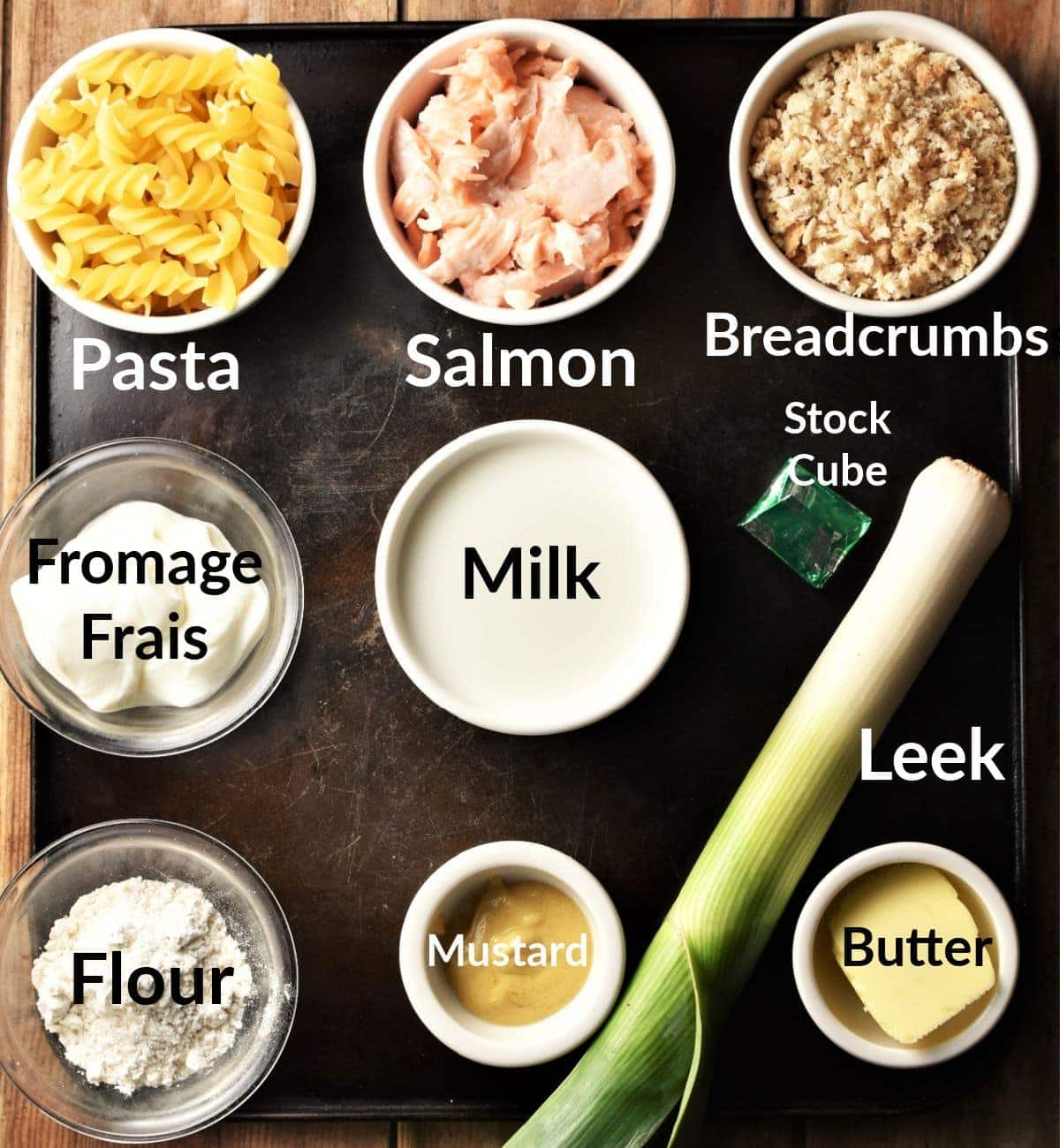 Salmon pasta bake ingredients in individual dishes.