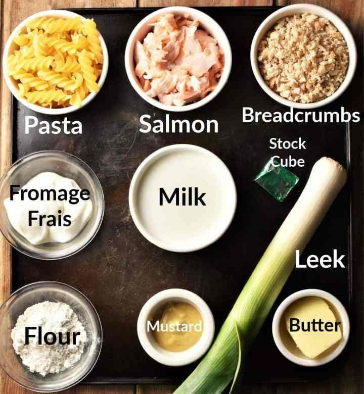 Salmon pasta bake ingredients in individual dishes.