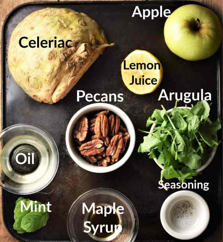 Celeriac salad ingredients in individual dishes.