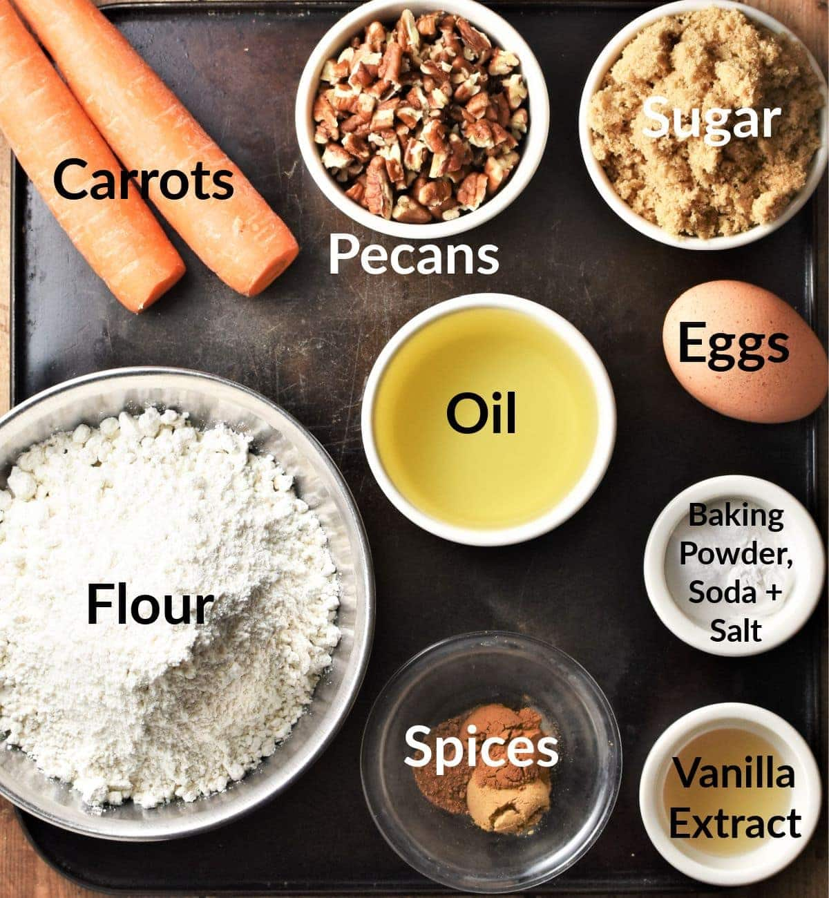 Low sugar carrot cake ingredients in individual dishes.