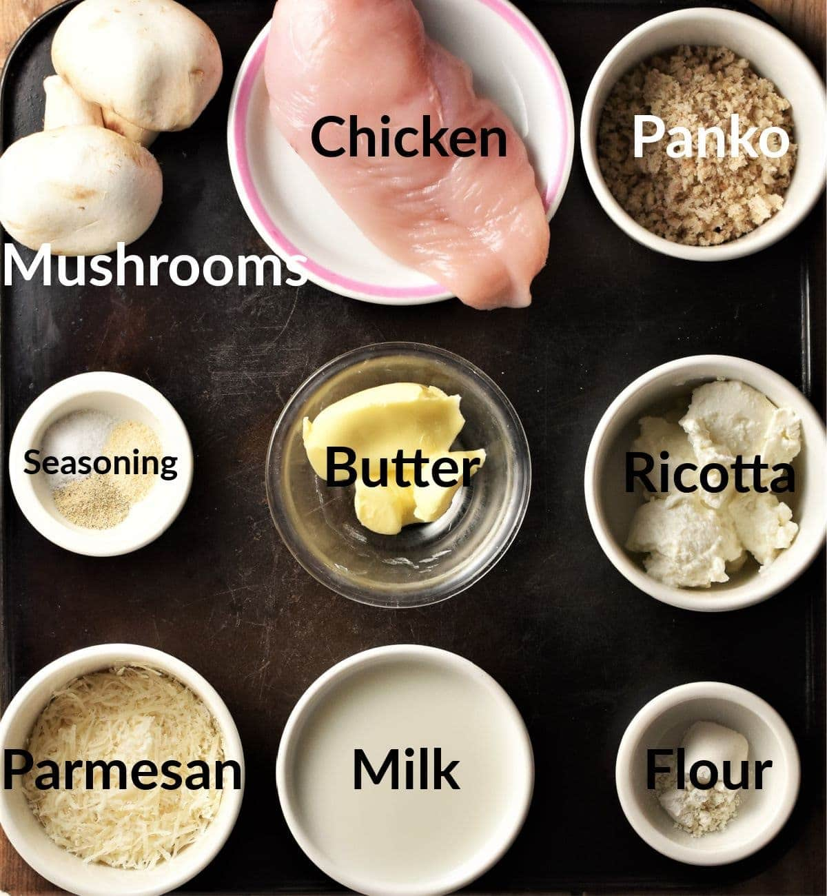 Mushroom stuffed chicken ingredients in individual dishes.