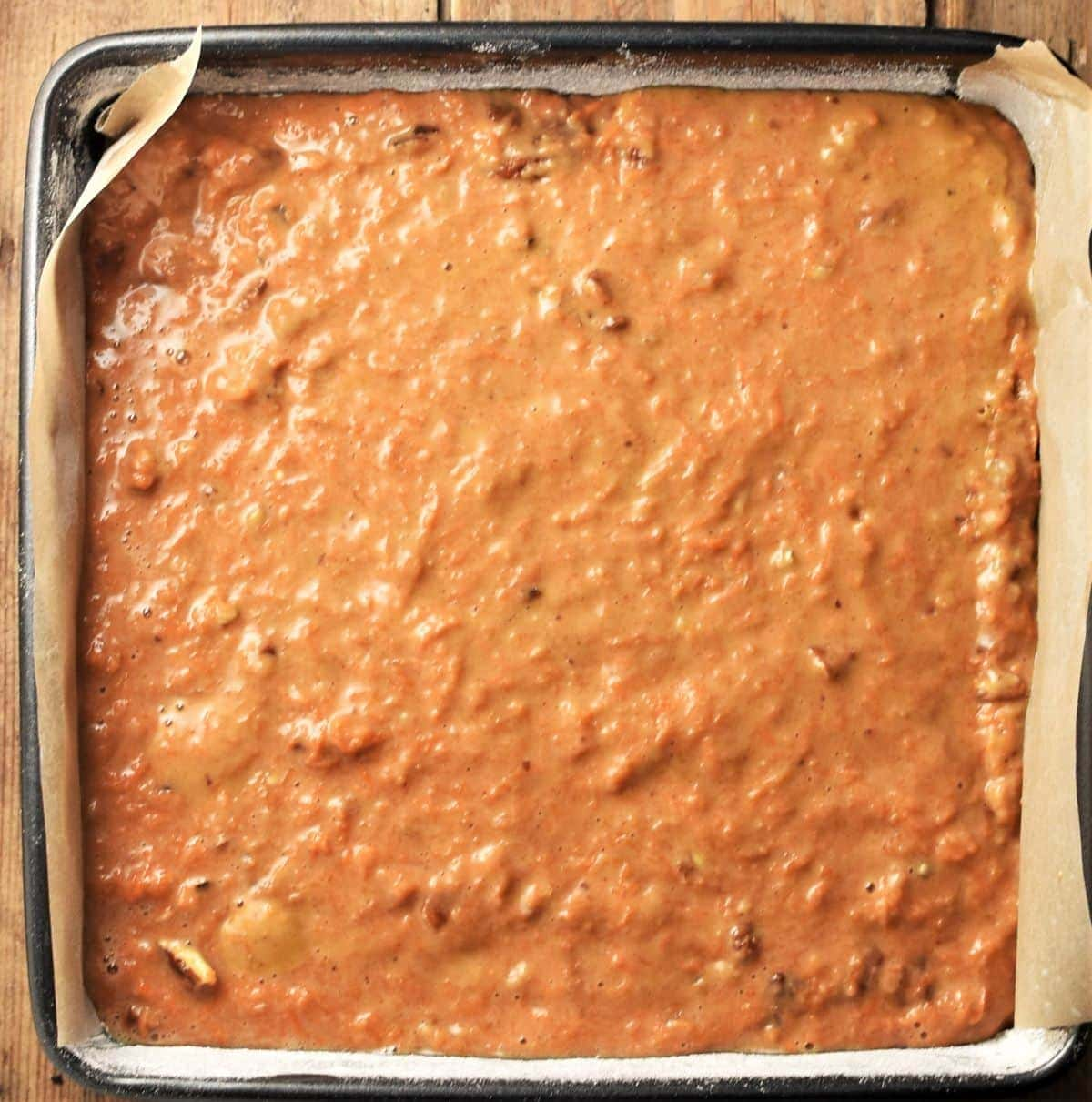 Carrot cake batter in square pan.