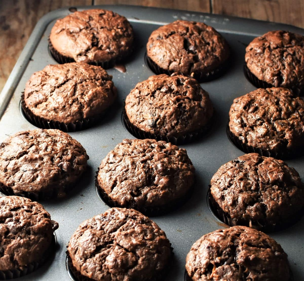 Side view of 12 muffins in pan.