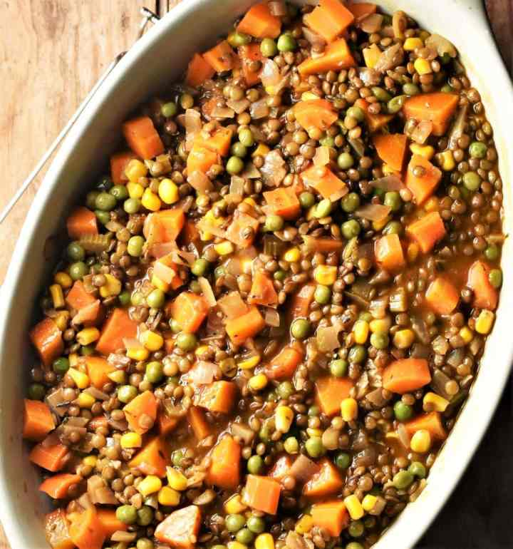 Lentil and vegetable pie filling in oval dish.