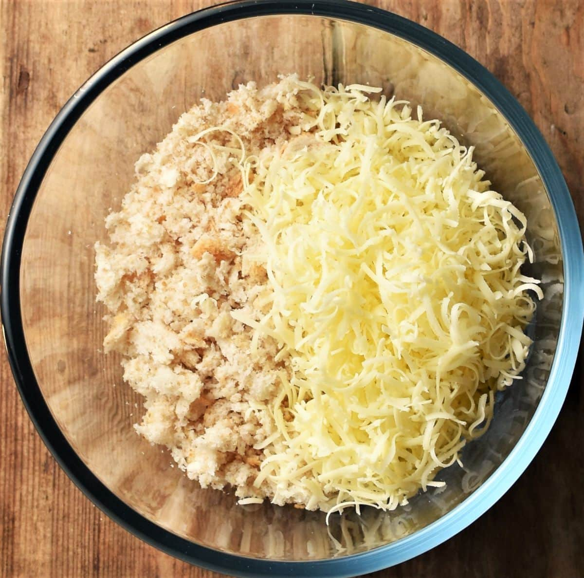 Fresh breadcrumbs with grated cheese in mixing bowl.