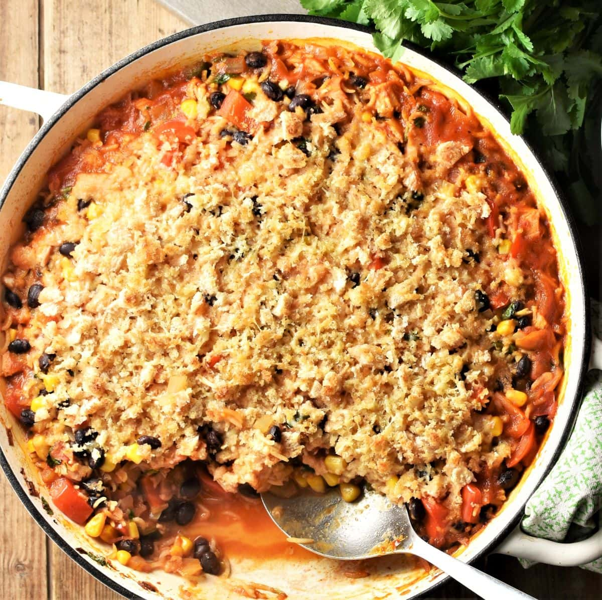 Turkey and rice casserole in large shallow pan with spoon.