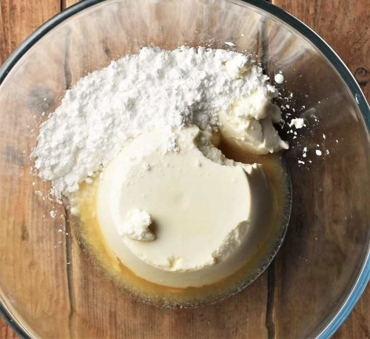 Ricotta, icing sugar and brandy in mixing bowl.