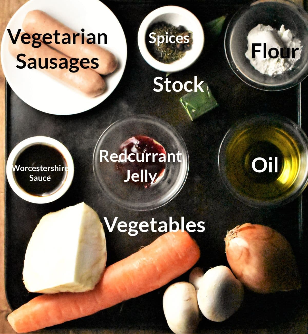 Ingredients for making vegetarian sausage pie in individual dishes.
