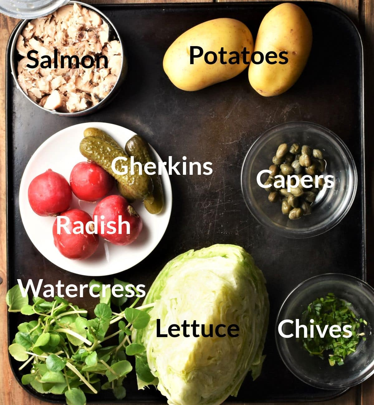 Ingredients for making tinned salmon salad in individual dishes.