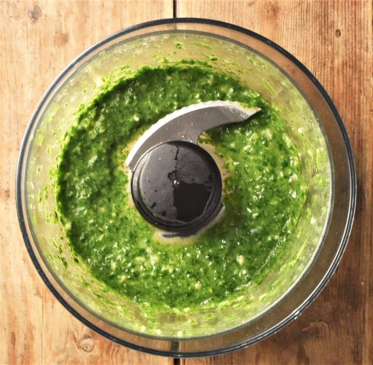 Fresh herb sauce in small blender.