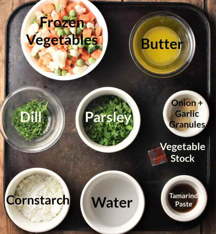 Ingredients for making chunky vegetable soup in individual dishes.