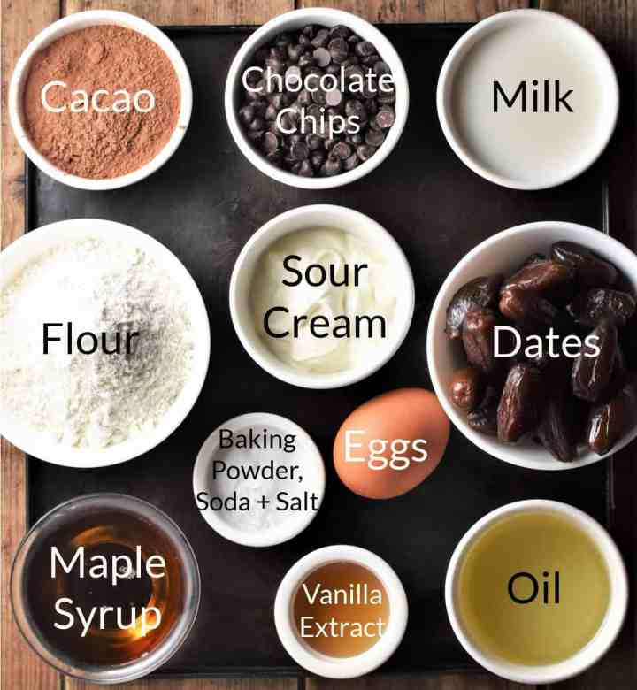 Ingredients for making healthy chocolate muffins in individual dishes.