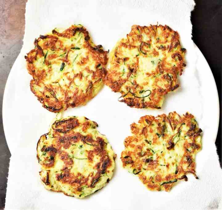 4 fritters on top of plate lined with paper towel.