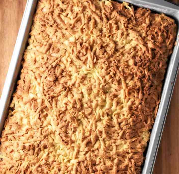 Apple crumble cake in rectangular pan.