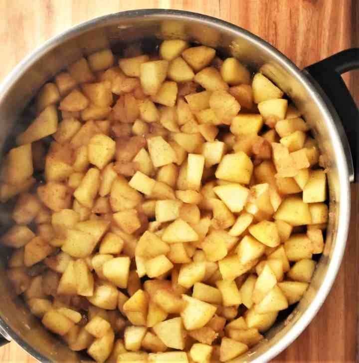 Cooked cubed apples in large pot.