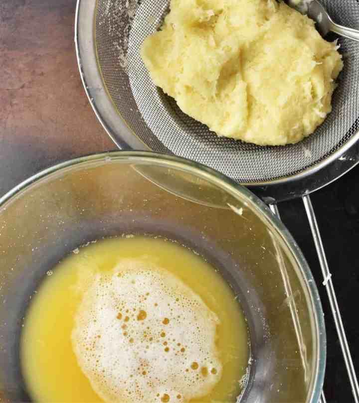 Shredded potato in sieve and potato water in bowl.