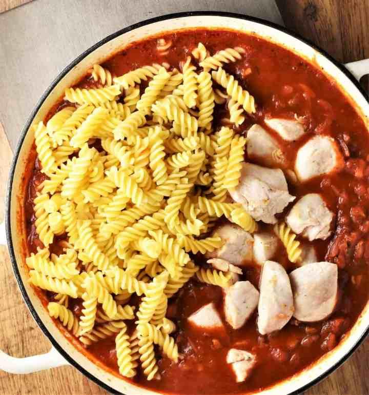 Fusilli pasta and chicken chunks in tomato sauce.