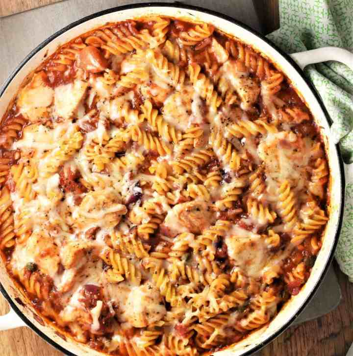 Pasta bake with chicken in large shallow round dish.