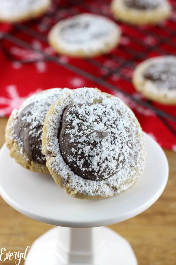 A classic peanut butter cookie with all the extras. These Muddy Buddy Cookies are filled with a creamy chocolate center and topped off with a dusting of powdered sugar. | EverydayMadeFresh.com