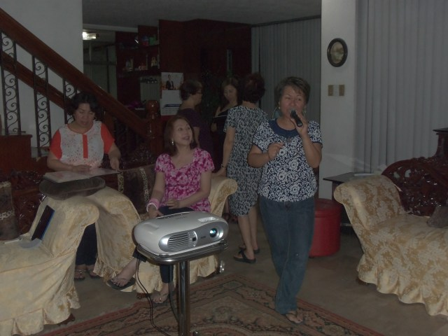 Singing karaoke with a twist with family in the Philippines.
