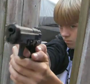 https://i0.wp.com/www.everydaynodaysoff.com/wp-content/uploads/2010/12/Driveway-Warfare-Kids-And-Guns.jpg