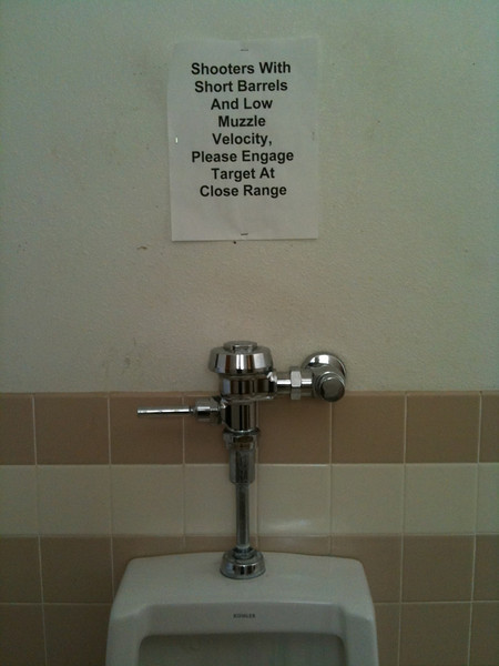 Sign At A Shooting Range Urinal
