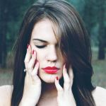 woman-eyes-closed-holding-face-in-hands-botox-side-effects-brain-changes