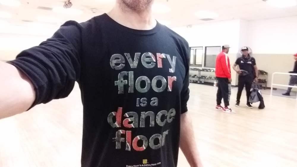 Reid Walley wearing an Every Floor Is A Dance Floor™ Camo Green Racer long sleeve dance t shirt at Step 1 Dance Studio in Sacramento, CA.