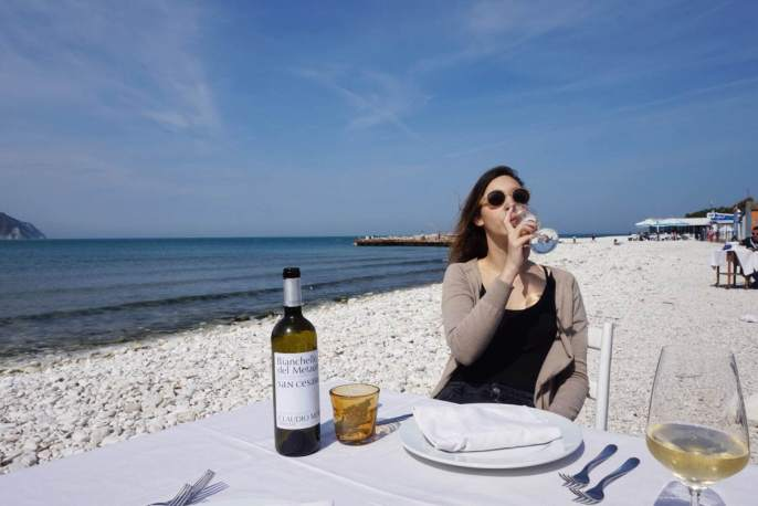 Sipping wine on the beach - What to do in Ancona, Italy