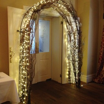 Wedding Arch With Lights  Flowers  Everything Covered