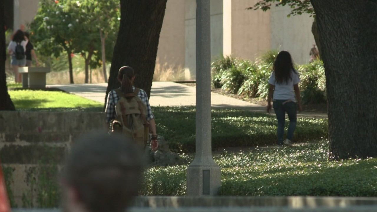 Students walking on UT campus_540702