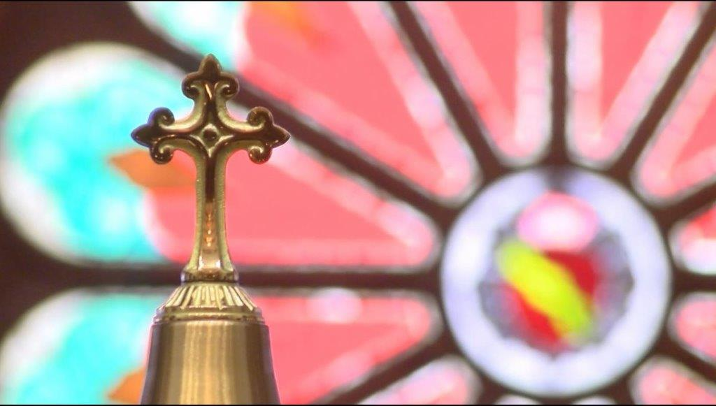 catholic church cross stained glass KXAN