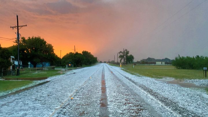 Hail on the roadway FM 179 south of Shallowater 720