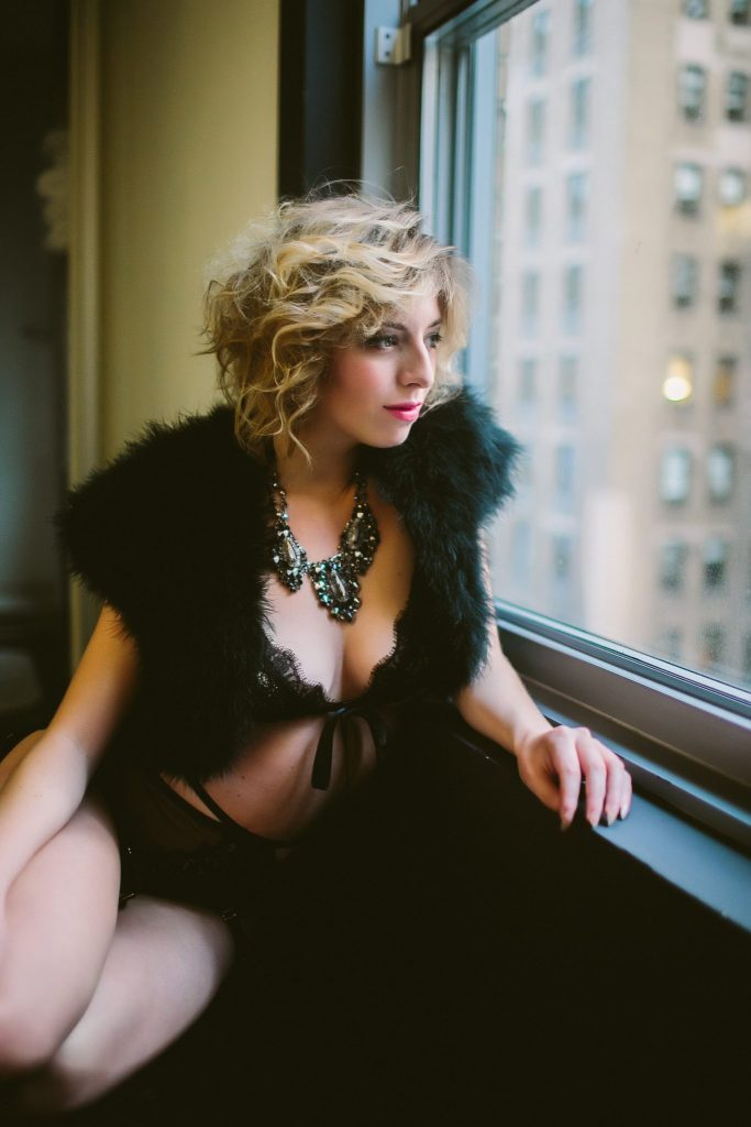 Gazing out at NYC while taking boudoir photos