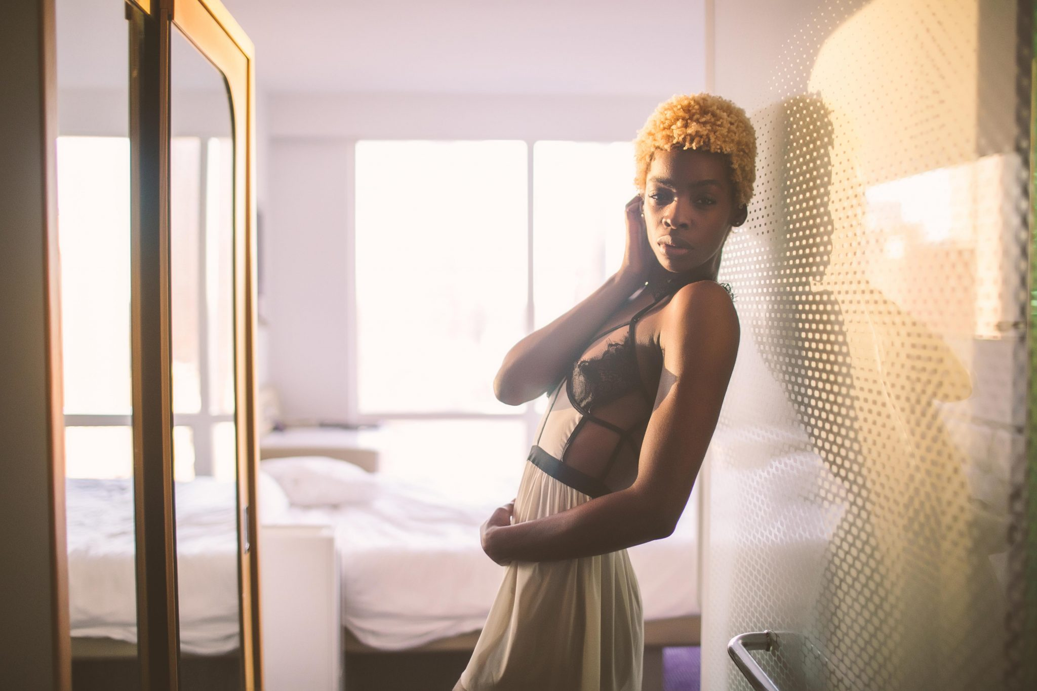 A sultry model taking a boudoir photo in a Manhattan hotel