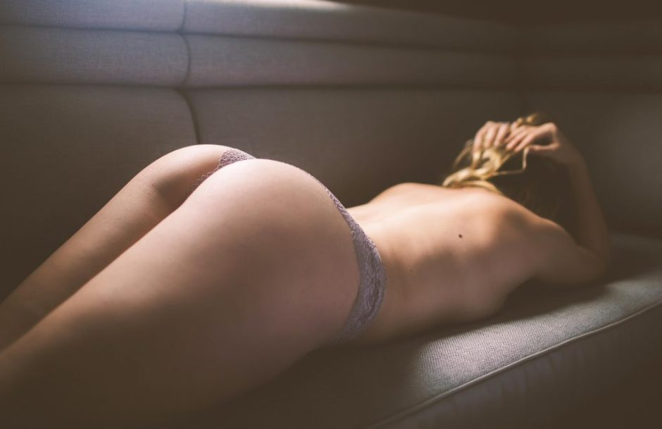 a sexy boudoir model posing in industry city